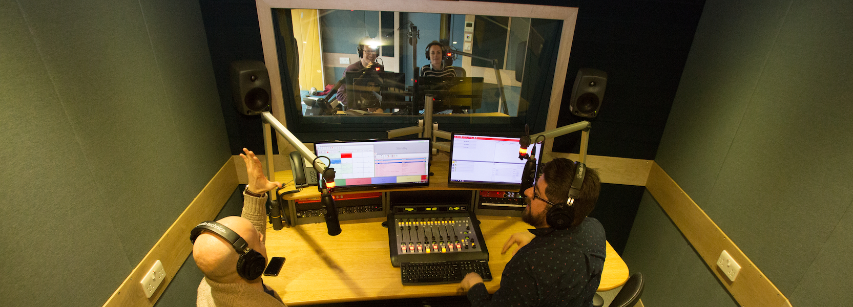 People broadcasting in a radio studio